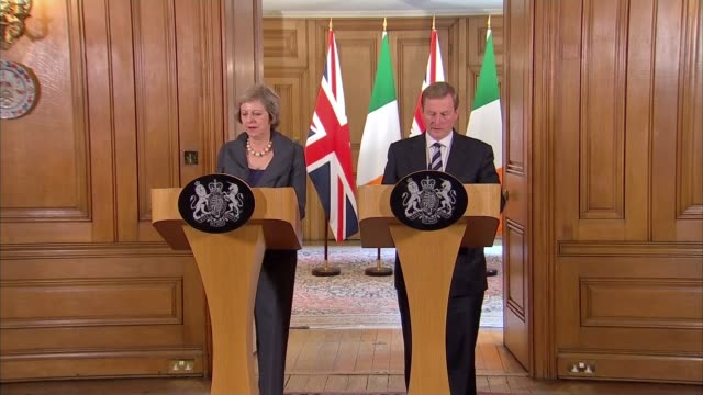 elderly priest murdered by alleged islamic state terrorists sky london downing street theresa may mp into room for press briefing with enda kenny... - ラゲ オマール点の映像素材/bロール