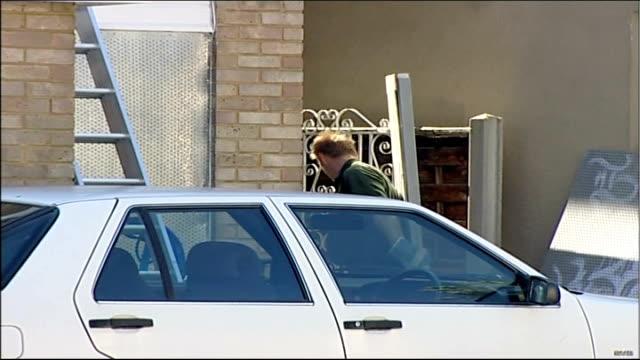 elderly woman evicted following land dispute with her neighbours bailiffs boarding up windows of markos' home bailiff carrying board away nicholas... - 立ち退き点の映像素材/bロール