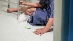 elderly woman falling in bathroom