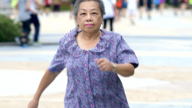 Elderly woman is jogging