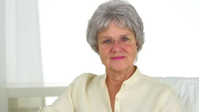 Elderly woman looking at camera
