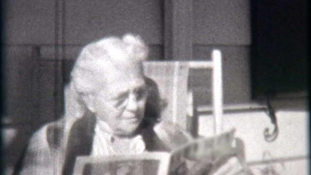 elderly woman reads magazine 1940 - archives stock videos & royalty-free footage