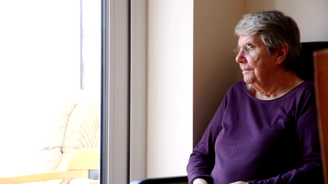 elderly woman sitting alone - sideways glance stock videos & royalty-free footage