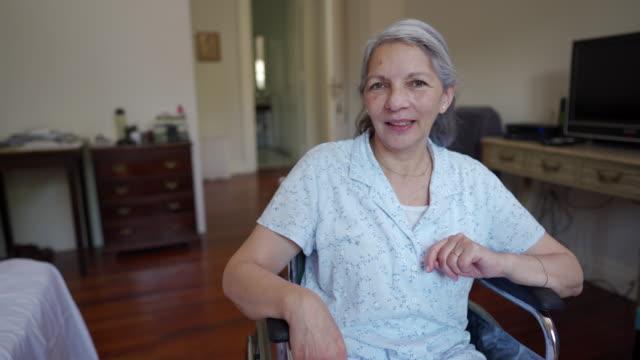 elderly woman sitting in wheelchair in nursing home - wheelchair stock videos & royalty-free footage