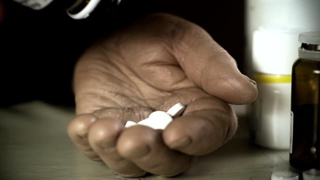 HD SLOW MOTION: Elderly Woman Spilling Pills