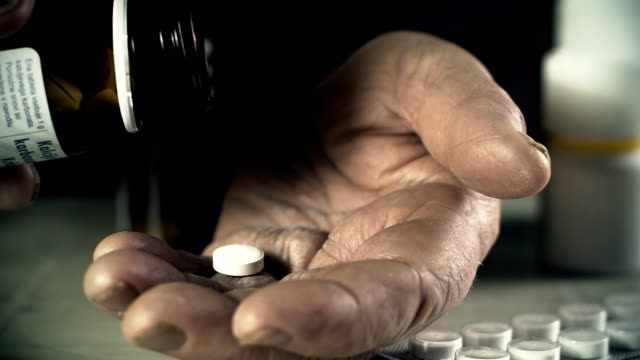 HD SLOW MOTION: Elderly Woman Taking A Pill