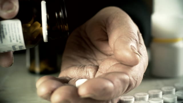hd: elderly woman taking a pill - taking medicine stock videos and b-roll footage