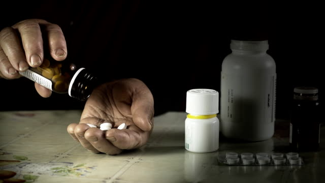 HD SLOW MOTION: Elderly Woman Taking Many Pills