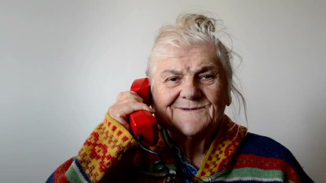 elderly woman talking on phone - one senior woman only stock videos and b-roll footage