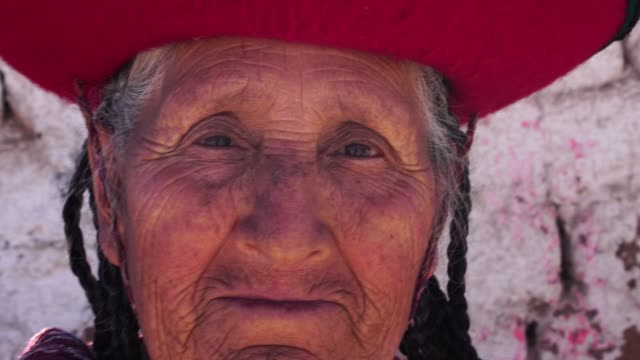 elderly woman wearing traditional hat in chinchero, peru - native american ethnicity stock videos & royalty-free footage