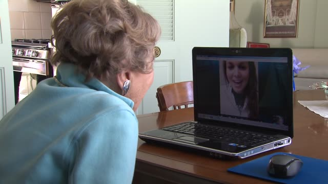 vídeos de stock e filmes b-roll de wgn elderly woman working on laptop computer elderly woman skyping on october 29 2013 in chicago illinois - skype