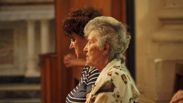 elderly women attend prayer service in church - Malta