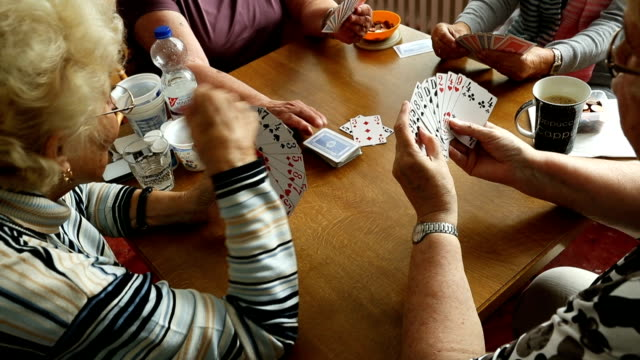 elderly women play a card game of rummy at the mireille mathieu senior citizens' center on september 20 2017 in berlin germany according to... - pensionierung stock-videos und b-roll-filmmaterial