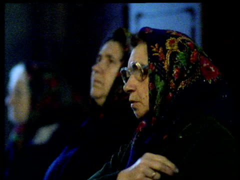 Elderly women praying in Russian Orthodox Church