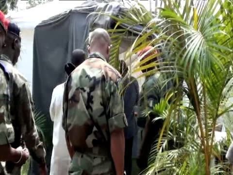 elected ivory coast president alassane ouattara holds a cabinet meeting in a tent at a hotel as incumbent leader laurent gbagbo refuses to relinquish... - côte d'ivoire stock videos & royalty-free footage