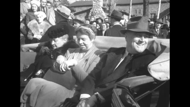 Election 1940 / Hyde Park New York Town Hall surrounded by people / open top car arrives with President Franklin Roosevelt and Mrs Eleanor Roosevelt...