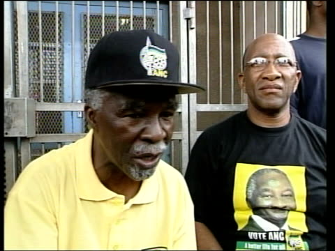 African National Congress expecting victory ITN Pretoria Thabo Mbeki wearing baseball cap on campaign trail waving to crowds GV cheering Mbeki...