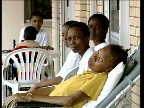 African National Congress expecting victory LIB AIDS sufferers sat on balcony of house Baby girl suffering from AIDS laying in cot EXT GV AIDS...