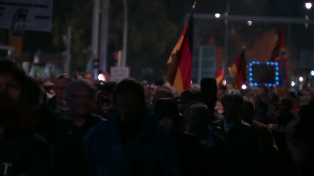 Angela Merkel reelected for fourth term GERMANY Dresden Various of people taking part in the weekly demonstration against the Islamisation of Germany...