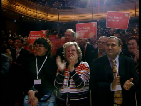 blair launches labour's six key pledges ls cs blair on stage with people holding pledge cards gv labour supporters holding labour slogans and... - liam fox politician stock videos and b-roll footage