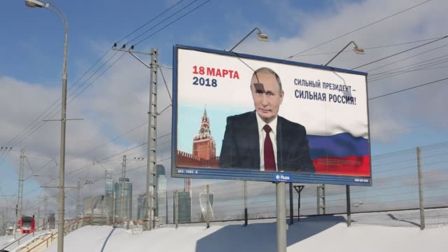 Election campaign billboard posters featuring incumbent Russian President Vladimir Putin stand on roadsides in Moscow Russia on Wednesday Feb 21 2018