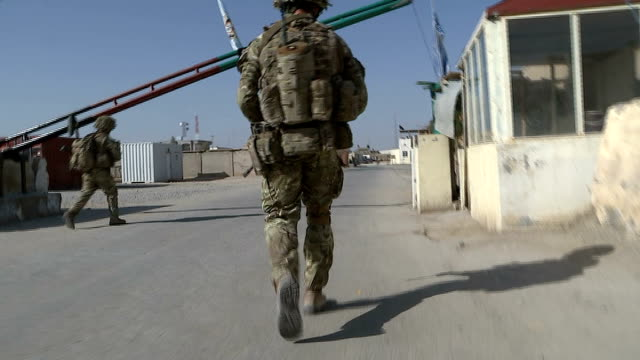 election campaigning continues / security rosemary day interview sot british soldier along through base camp afghan soldier passes in opposite... - base camp stock videos and b-roll footage