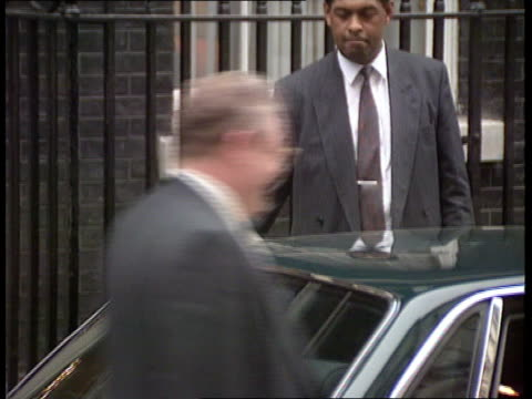 London Downing Street MS John Major PM out of No10 and into car TMS Cars away MS Neil Kinnock MP toward in corridors BV Kinnock away through corridor