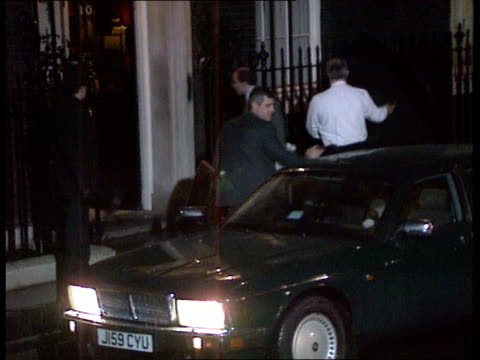 London Downing Street LMS John Major PM getting out of car under umbrella and into No10 LMS Chris Patten MP getting out of car with large case and...