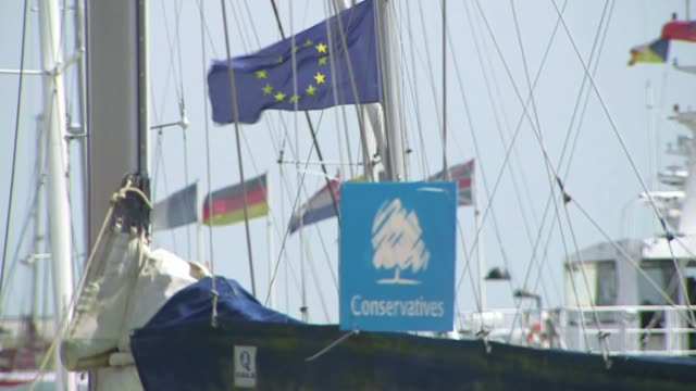 stockvideo's en b-roll-footage met further claims emerge t04051522 / tx kent ramsgate signs 'conservatives' attached to yacht in marina sign 'conservatives' on boat with eu flag flying... - ramsgate