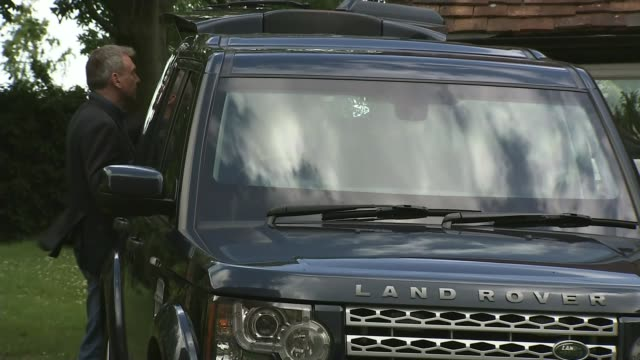 Speculation over Theresa May's future Boris Johnson MP into Range Rover car as press shout questions SOT