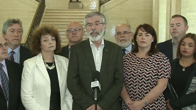 dup powersharing negotiations / northern ireland reaction stormont int gerry adams towards with others/ gerry adams press conference sot we dont... - ストーモント点の映像素材/bロール