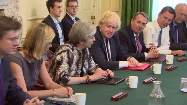 queen's speech delayed / dup negotiations / theresa may meets backbenchers england london 10 downing street int various shots of theresa may mp... - 数字の10点の映像素材/bロール