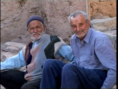 mahmoud ahmadinejad supporters; south tehran ext gv group of old men sit in street by ruins of houses two old men sitting in street old man stands... - iran stock videos & royalty-free footage