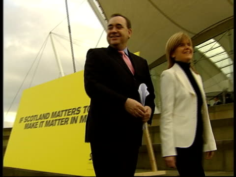 ext alex salmond and other along to launch snp election manifesto salmond and other posing in front of 'if scotland matters to you make it matter in... - scottish national party stock videos & royalty-free footage