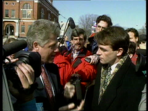 vídeos de stock, filmes e b-roll de new hampshire primary usa new hampshire manchester bill clinton talking to bill neely sof we can do well here cms clinton in street campaigning cms... - primary election