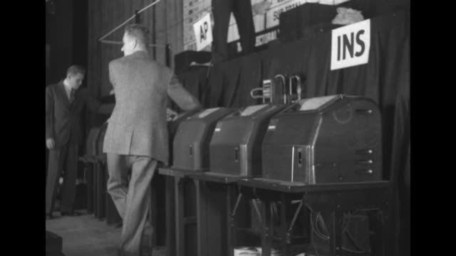 ws 1940 election night returns at nbc studio with chart desk copy desk broadcast booth with on the air lighted sign lit up seated audience watching... - voting booth stock videos & royalty-free footage
