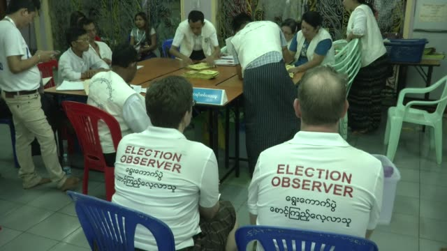 Election Observers watch ballots being counted at a polling station in Yangon during Myanmar's first free and fair election The elections will be...