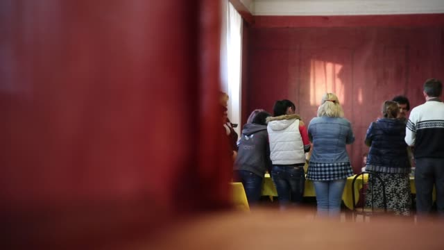ws election officials celebrate an election official counts votes in a polling station in the lenin palace of culture in slovyansk in eastern ukraine... - eastern european culture stock videos and b-roll footage