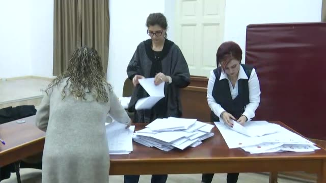 Election officials count ballots at a polling station during the snap general elections in Lefkosa on January 07 2018