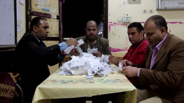 election officials count ballots on the last day of the 2018 egyptian presidential elections in faiyum, egypt, on march 28, 2018. - last day stock videos & royalty-free footage