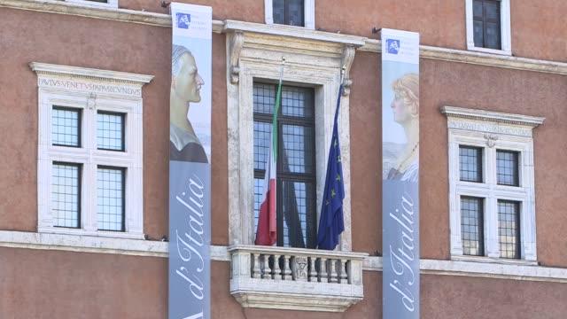 resurgence of fascist inspired movements italy rome ext balcony building in piazza venezia and advertisement poster 'sono tornato' mockumentary poster - piazza venezia stock videos and b-roll footage