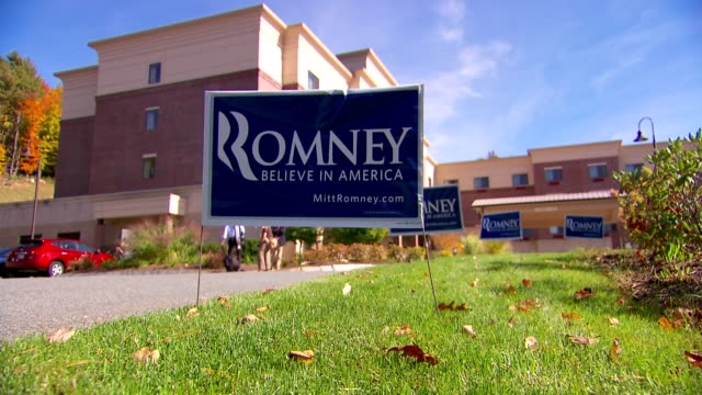 stockvideo's en b-roll-footage met ms election signs promoting mitt romney for president / election signs are surrounded by bright green lawn and fall leaves romney election signs on... - presidentskandidaat