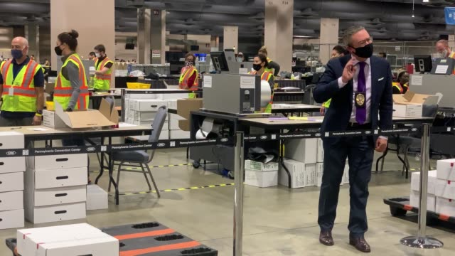 stockvideo's en b-roll-footage met election workers count ballots on november 04, 2020 in philadelphia, pennsylvania. with no winner declared in the presidential election last night,... - philadelphia pennsylvania