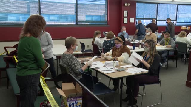 election workers in the city of wilkes-barre, in the battleground state of pennsylvania, count mail-in ballots submitted in the us election, where no... - wilkes barre stock videos & royalty-free footage