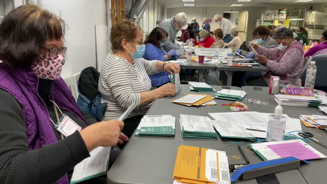 election workers sort absentee ballots to count at the lansing city clerk's office on election night on november 03, 2020 in lansing, michigan.... - joe 03 stock videos & royalty-free footage