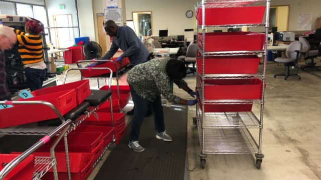 election workers wearing protective gloves organize mailedin ballots at the king county elections processing center on march 09 2020 in renton... - wahlschein stock-videos und b-roll-filmmaterial