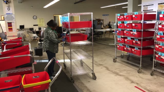 election workers wearing protective gloves organize mailedin ballots at the king county elections processing center on march 09 2020 in renton... - voting ballot stock videos & royalty-free footage