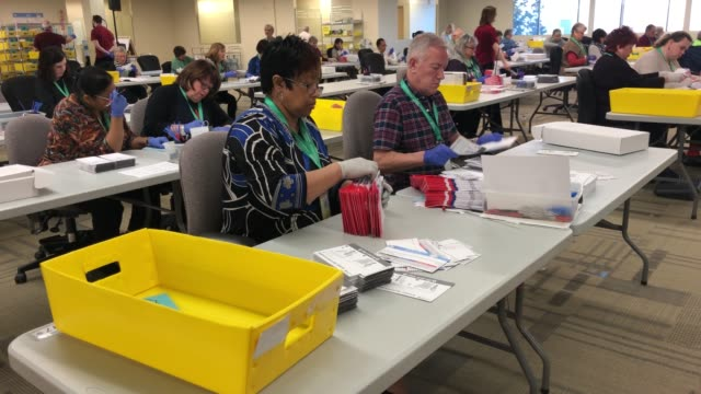 election workers wearing protective gloves sort through mailedin ballots at the king county elections ballot processing center on march 09 2020 in... - voting ballot stock videos & royalty-free footage