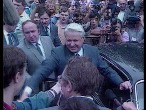 Elections Boris Yeltsin USSR Russian Federation EXT TCMS Yeltsin by car waving to crowds with press around ZOOM IN INT CMS Gorbachev seated at desk...