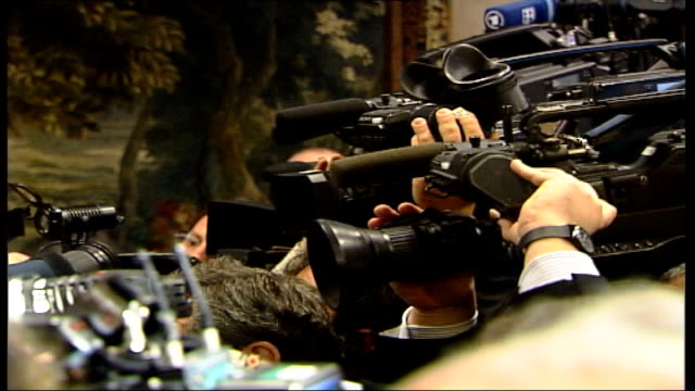 controversy surrounding silvio berlusconi italy rome silvio berlusconi at photocall and shakes hands side press cameras berlusconi posing for... - babies in a row stock videos & royalty-free footage
